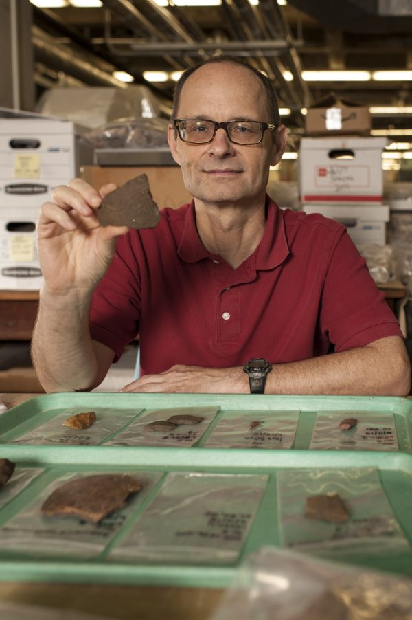Charles Cobb displays a pottery sherd
