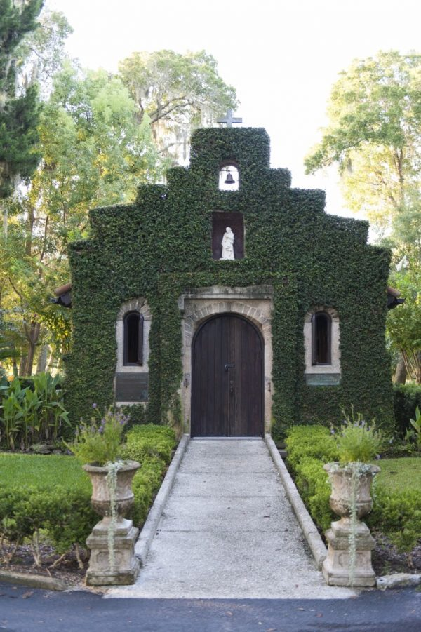small chapel covered with ivy