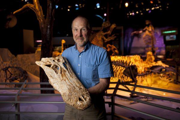 David holding alligator fossil skull