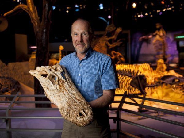 David holding alligator fossil skull