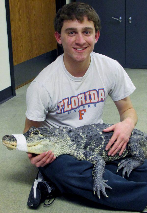 Evan holding baby alligator