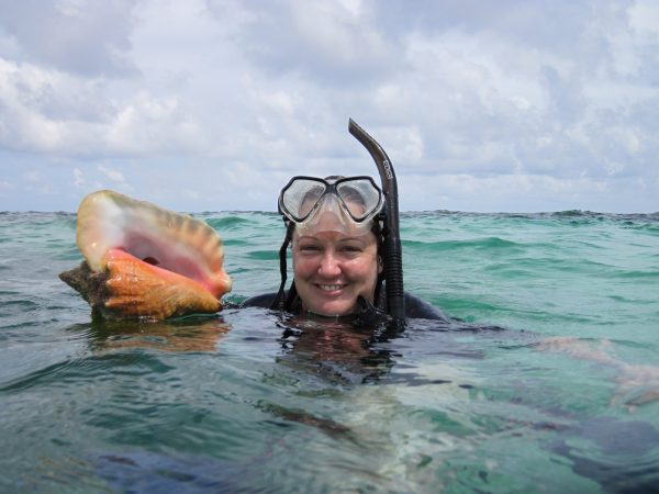 Carrie Tyler snorkeling with conch shell