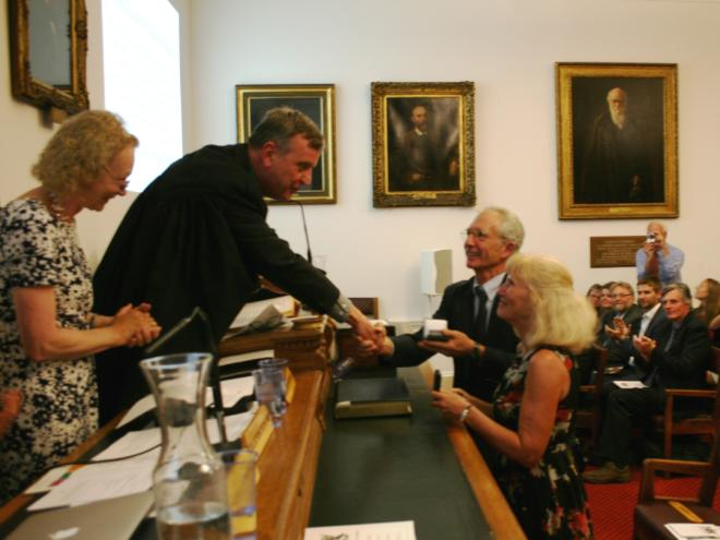 Pam and Doug Soltis receiving the Darwin-Wallace Medal