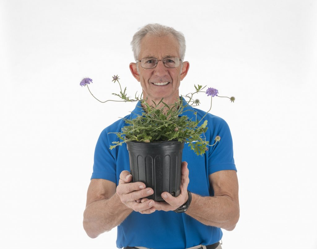 Doug Soltis holding potted plant