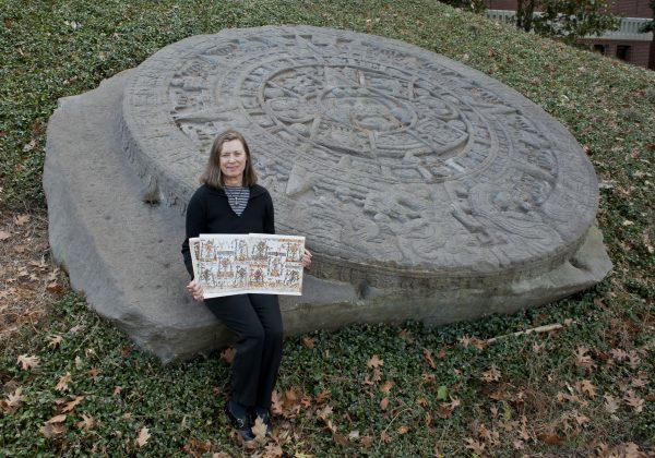 Susan Milbrath with Aztec stone