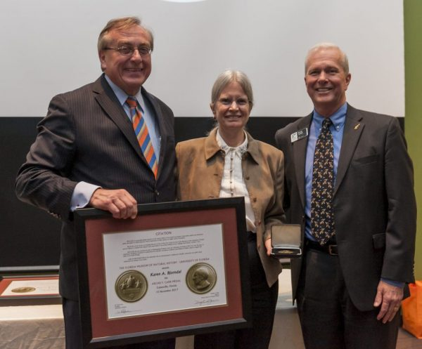 University of Florida President W. Kent Fuchs, left, and Museum Director Doug Jones present the 2017 Archie Carr Medal Award to Karen Bjorndal. Florida Museum photo by Kristen Grace