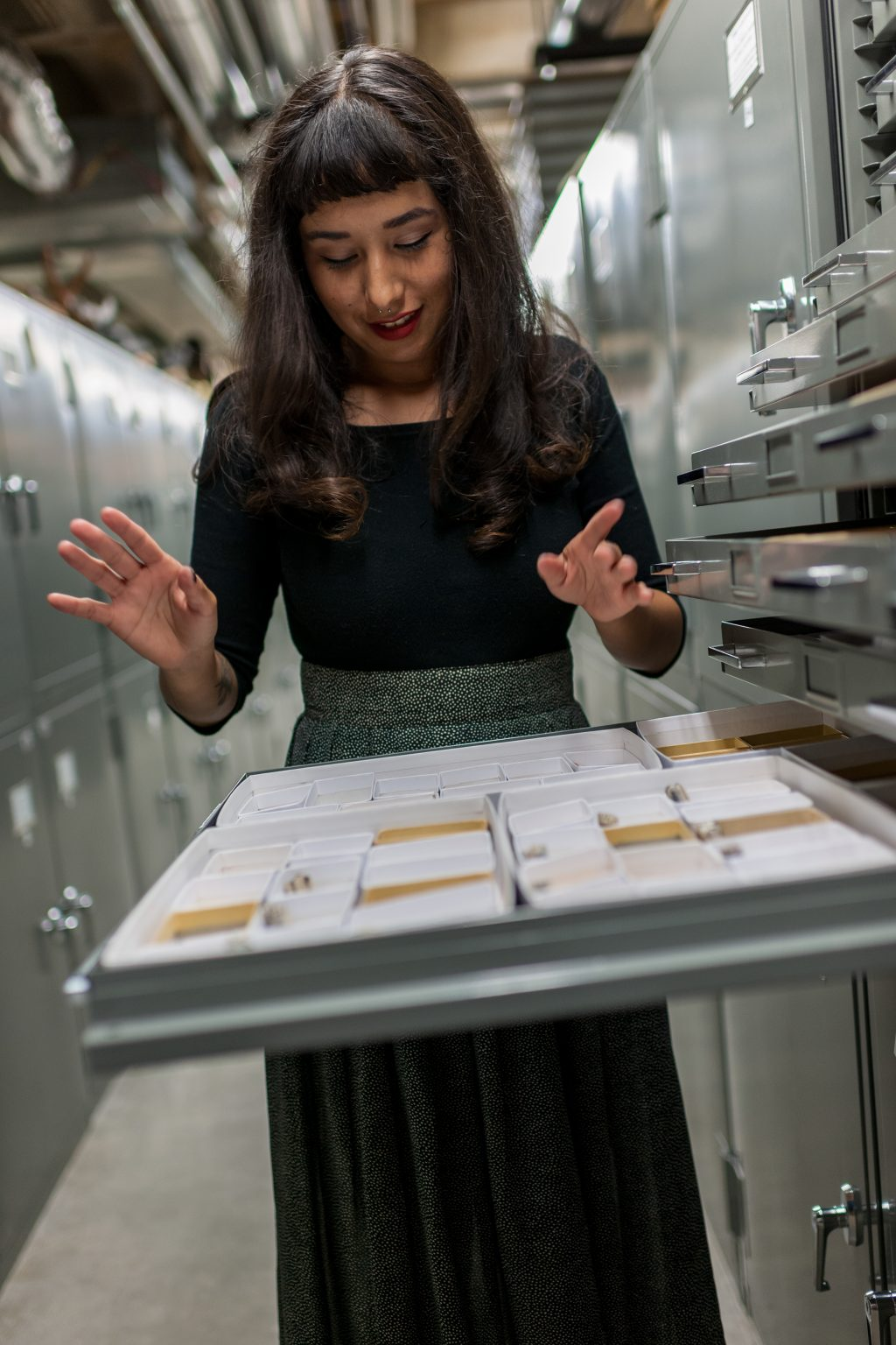 Michelle Barboza looking at fossils