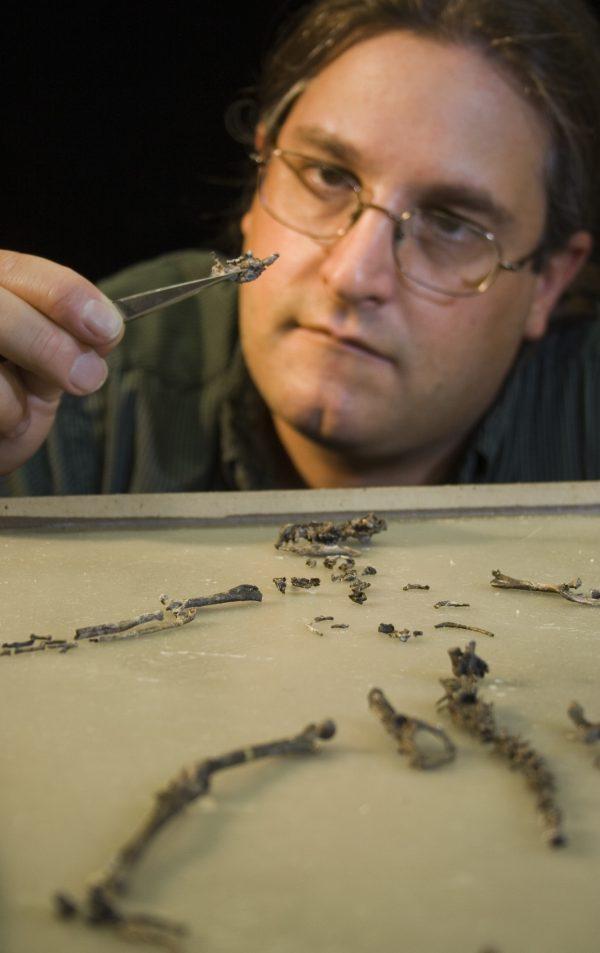 Jonathan Bloch examines a jawbone