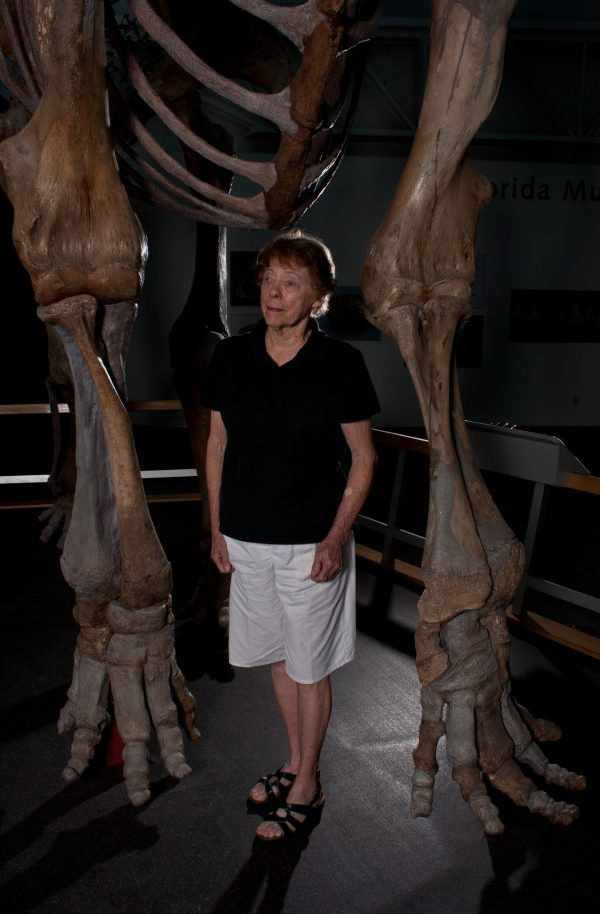 Purdy stands under mammoth skeleton