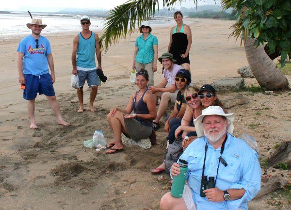 teachers seated on the beach
