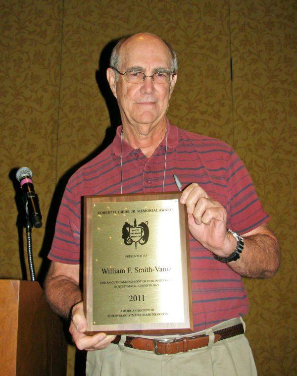 William Smith-Vaniz with award plaque