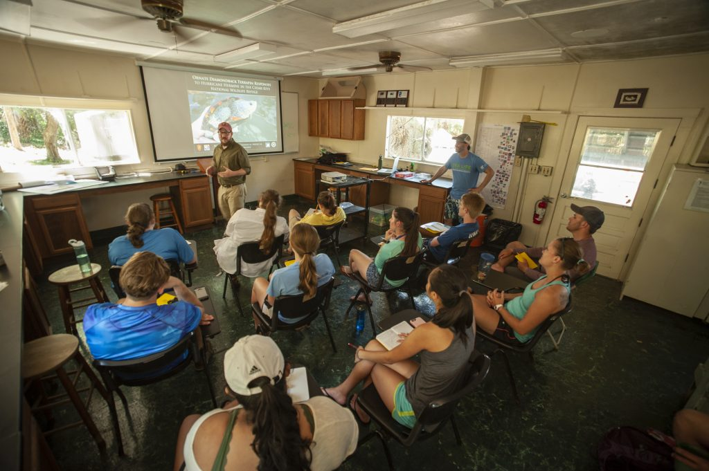 Students listen to a lecture in the island lab classroom.