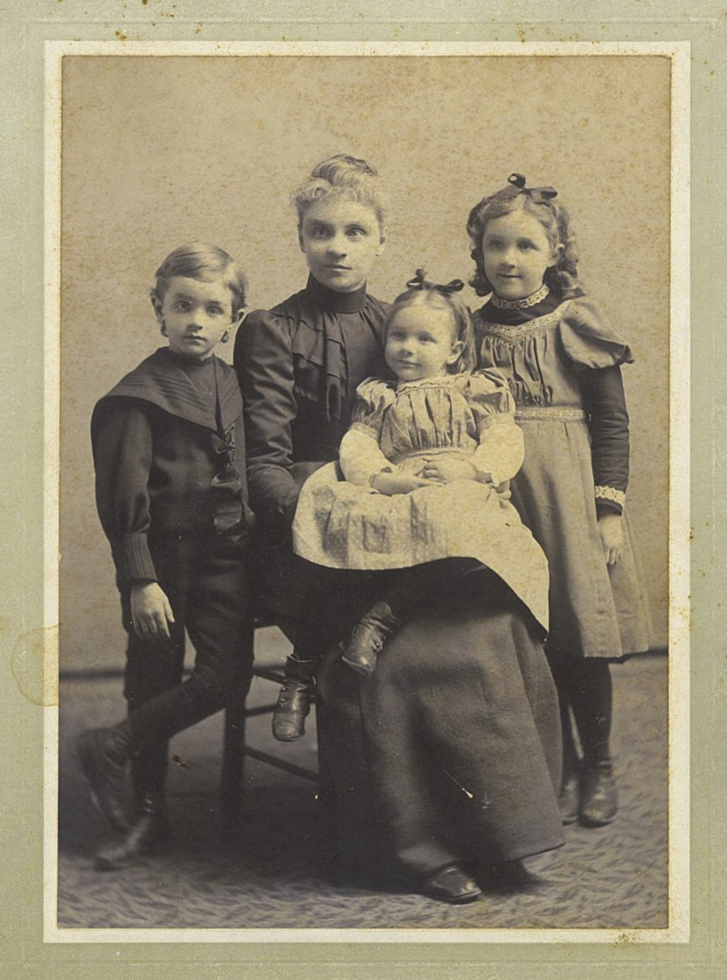 Fernald and her three children pose for a photo