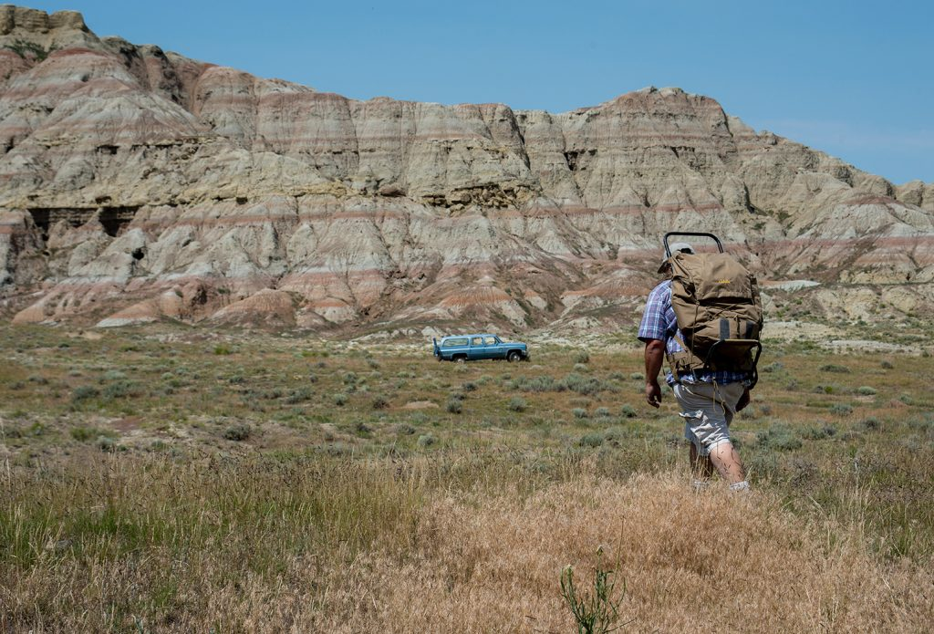 man walking in Wyoming's Badlands