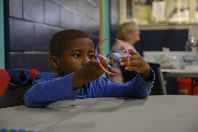 child holding hoop glider