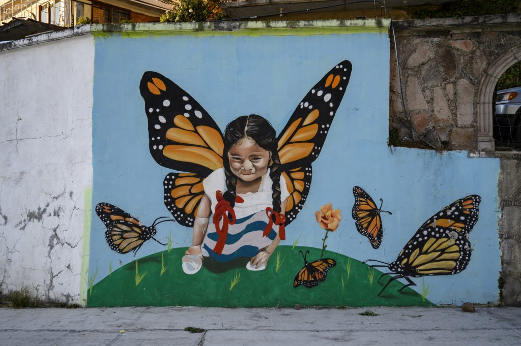 mural of girl with monarch wings