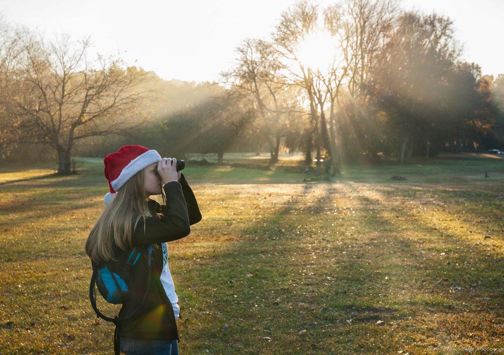 birder with binoculars