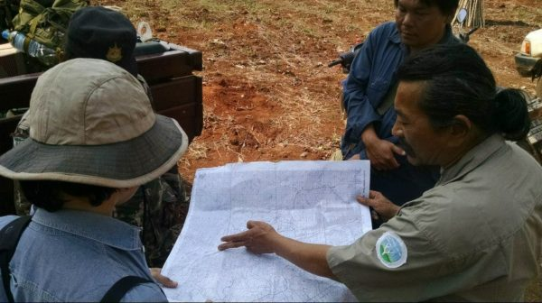 man pointing to map