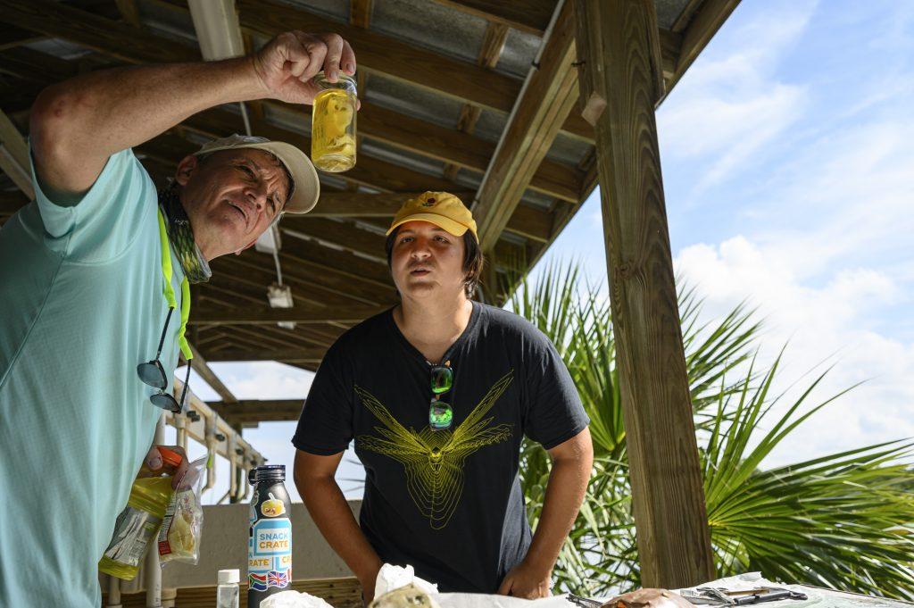 Gavin and student examine specimen