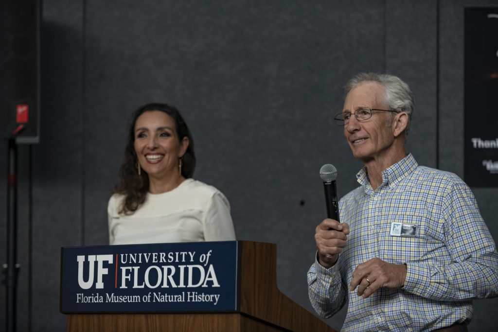 A man and woman at a podium