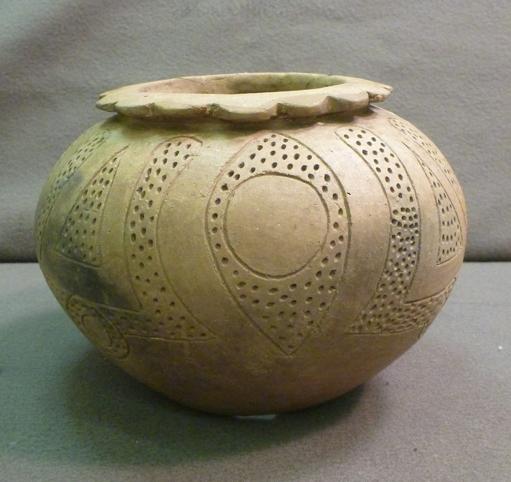 beige pot with design