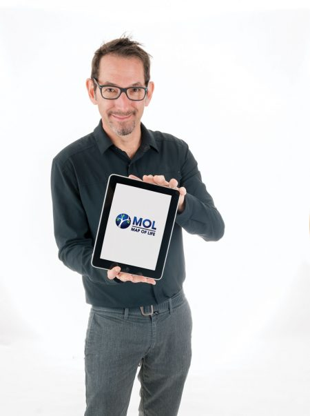 A scientist holding a tablet