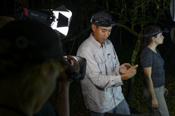 Akito Kawahara holding moth