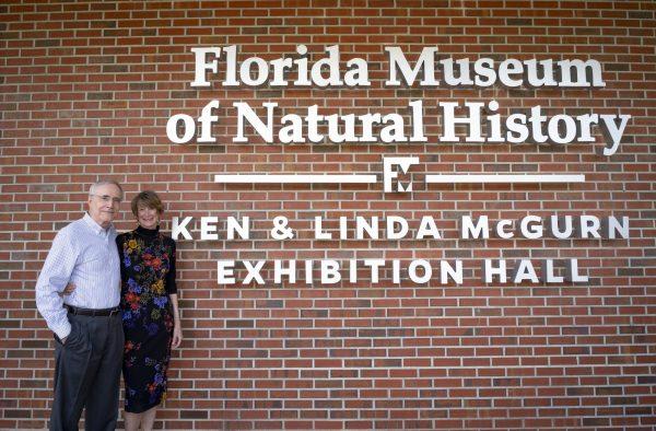 Ken and Linda McGurn in front of building