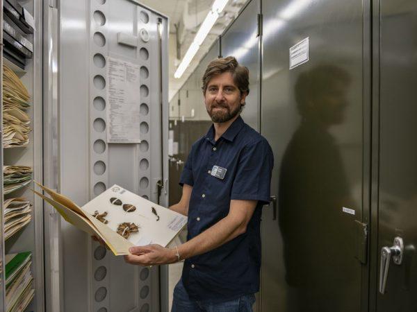 Lucas Majure holds herbarium specimen