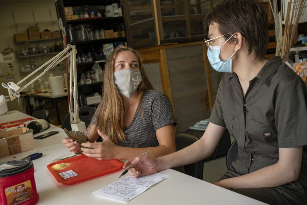 Rachel Woods and Hannah Chelgren prepare an ovenbird specimen