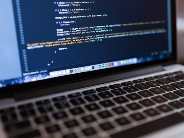 laptop showing code onscreen