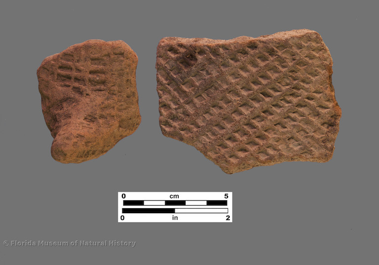 2 sherds with deep check stamping, including 1 podal support