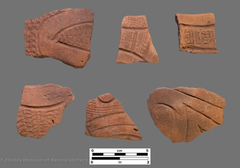 6 sherds of curvilinear incised pottery with stamped zones