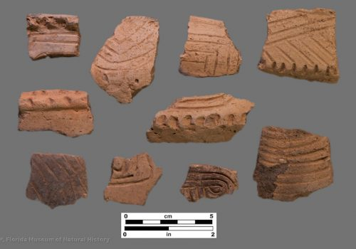 10 sherds of pottery with straight and curvilinear incisons