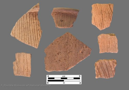 7 sherds of pottery with linear incised or brushed surfaces