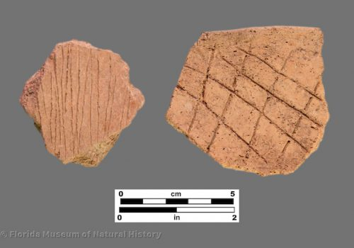 2 sherds of pottery with linear and cross-hatched designs