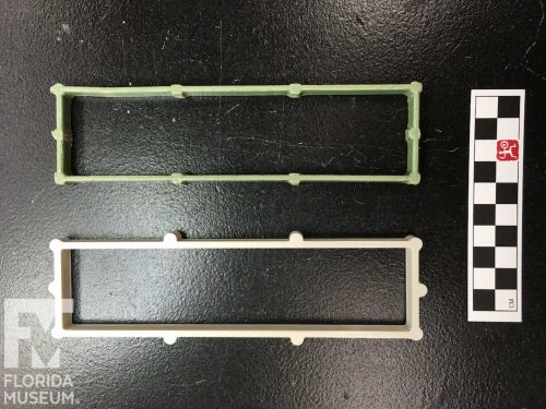 Two open rectangles of plastic