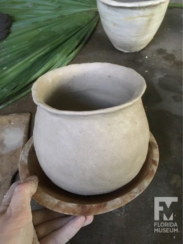 pot sitting in wooden bowl
