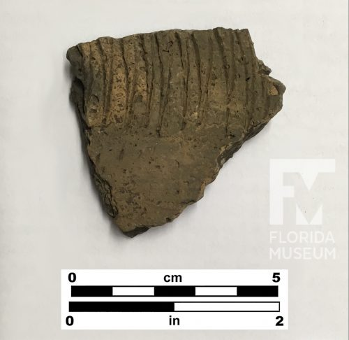 Pottery sherd with zig-zag line decoration and small pits