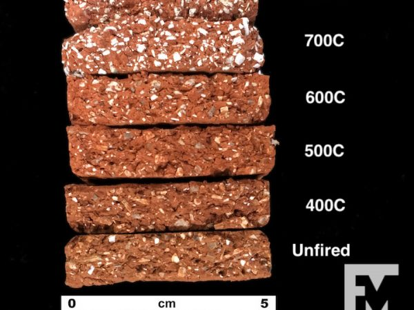 stack of briquettes ranging from unfired clay to 800 degrees celsius. The inclusions 600 and below are brownish/gray, and above 700 are white and larger