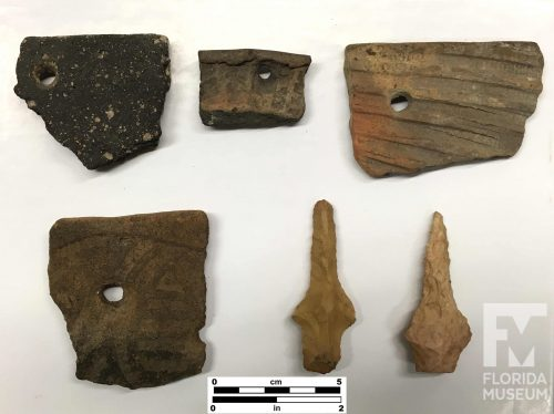 sherds, each with one small round hole, and two stone drilling tools