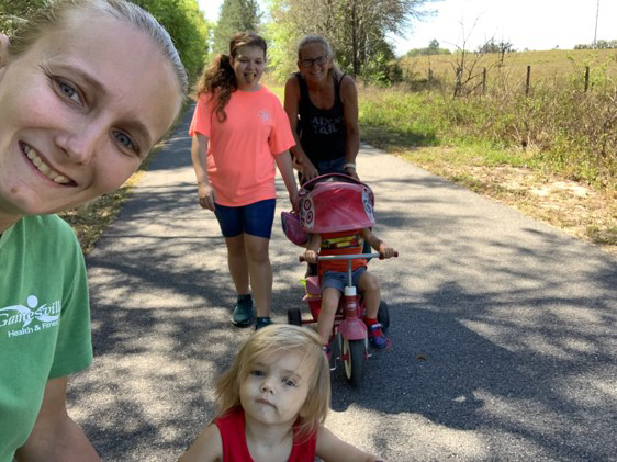 Virtual 5K runners including two toddlers, one on a tricycle