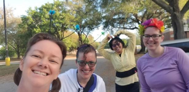 Four virtual 5K runner's celebratory selfie. One runner is wearing a flower headband.