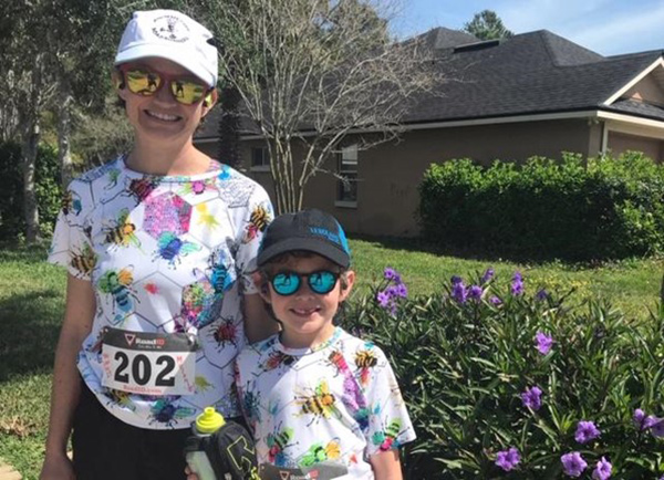 Virtual 5K runner 202 and young child both in t-shirts printed with mulit-colored bees.