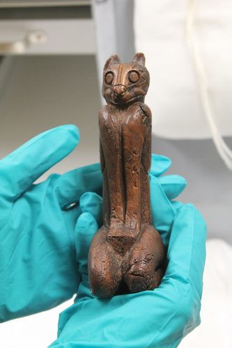 wooden carving on a cat