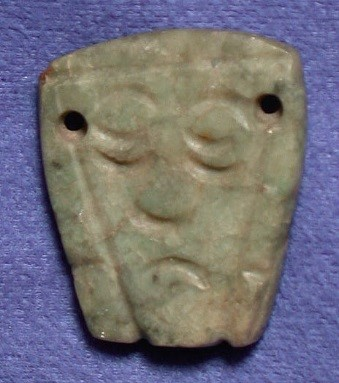 Pendant with a human face