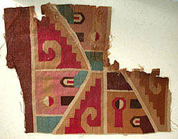 Textile fragment representing an abstract winged deity Peru, Southern Highlands or Coast, Middle Horizon (A.D. 500-900)