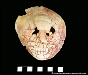 Skull-engraved Spondylus americanus shell. Photo courtesy of the Ceibal-Petexbatun Archaeological Project.