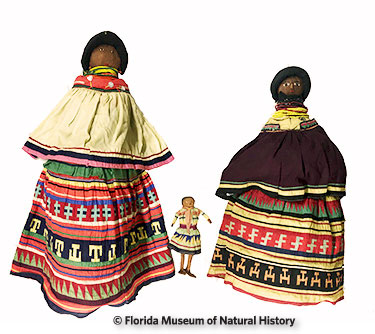 Figure 23: Large Seminole dolls compared to normal sized doll. (2014-12-16/2012-50-32/2014-12-15) 84cm/32cm/70cm. Larger dolls were donated by Reggie, Paula, and Amanda Clauser. Smaller doll was donated by Anne Reynolds.