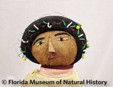 Figure 9: Female doll with beaded hairnet.